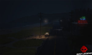 Vue d'un motel près d'une plage la nuit. Un enfant est assis sur un rocher sur la plage.