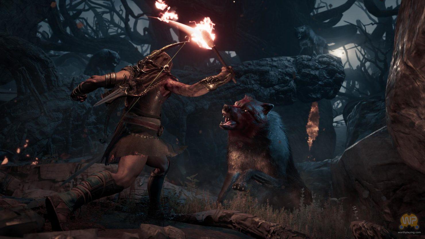 Assassin's Creed Odyssey assassin avec une torche contre loup, en pleine nuit