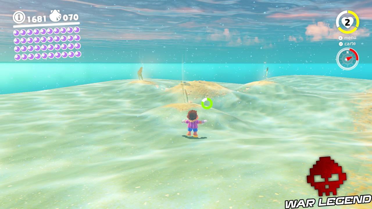 mario devant quatre monticules de terre sous l'eau