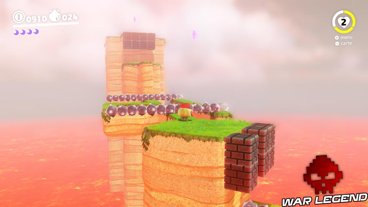 paysage de magma, quelques pytons de terre s'élèvent, lune rose dans les airs