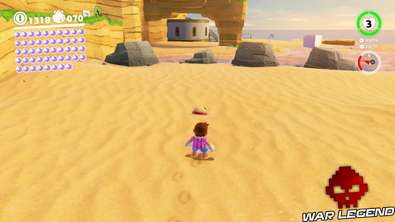 mario sur la plage devant quatre rochers