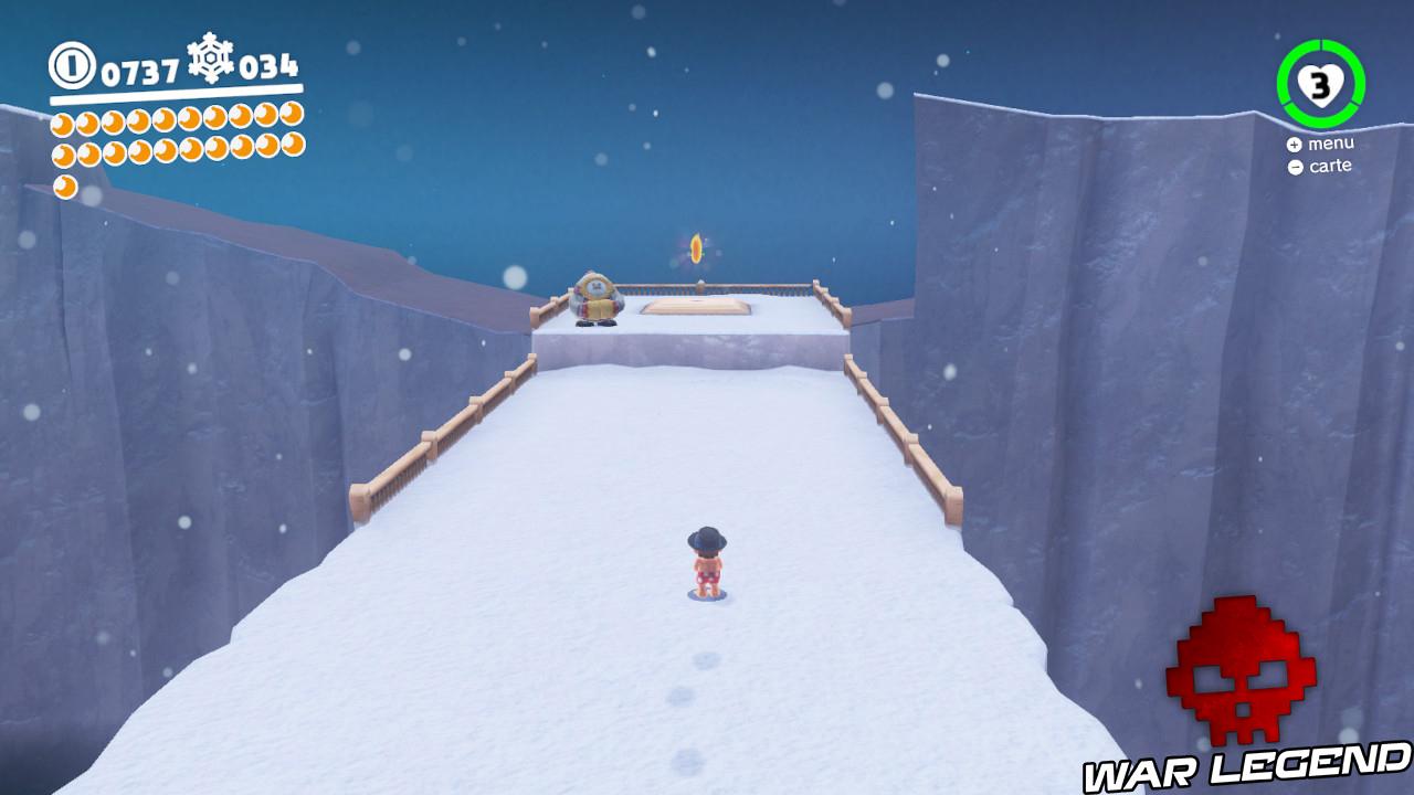 mario sprint sur une étendue de neige en direction d'une lune et d'un Flon