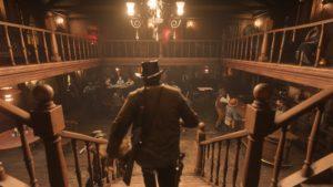 Red Dead Redemption 2 screenshot morgan descend les escaliers d'un saloon