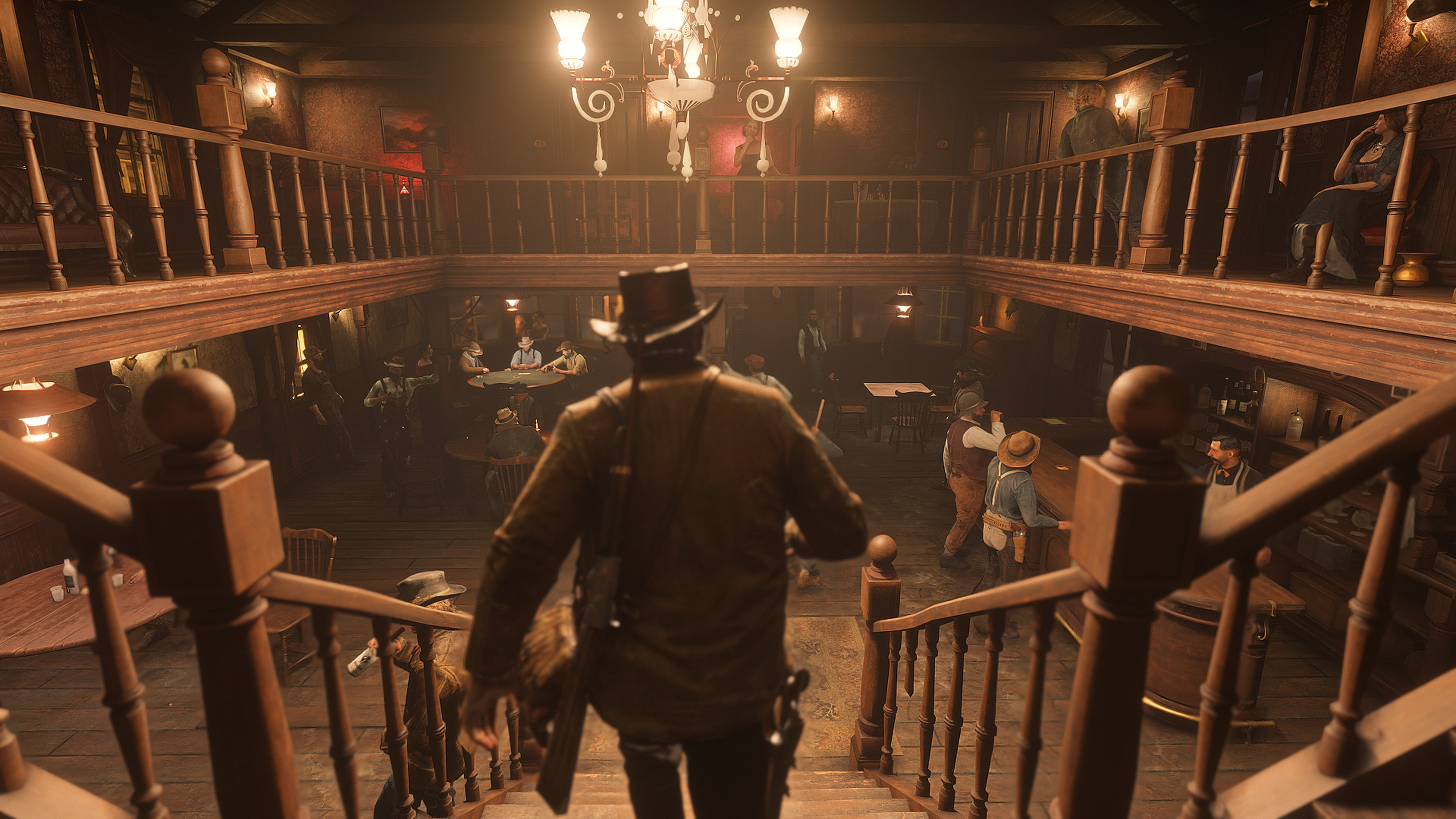 Red Dead Redemption 2 screenshot morgan descend les escaliers d'un saloon