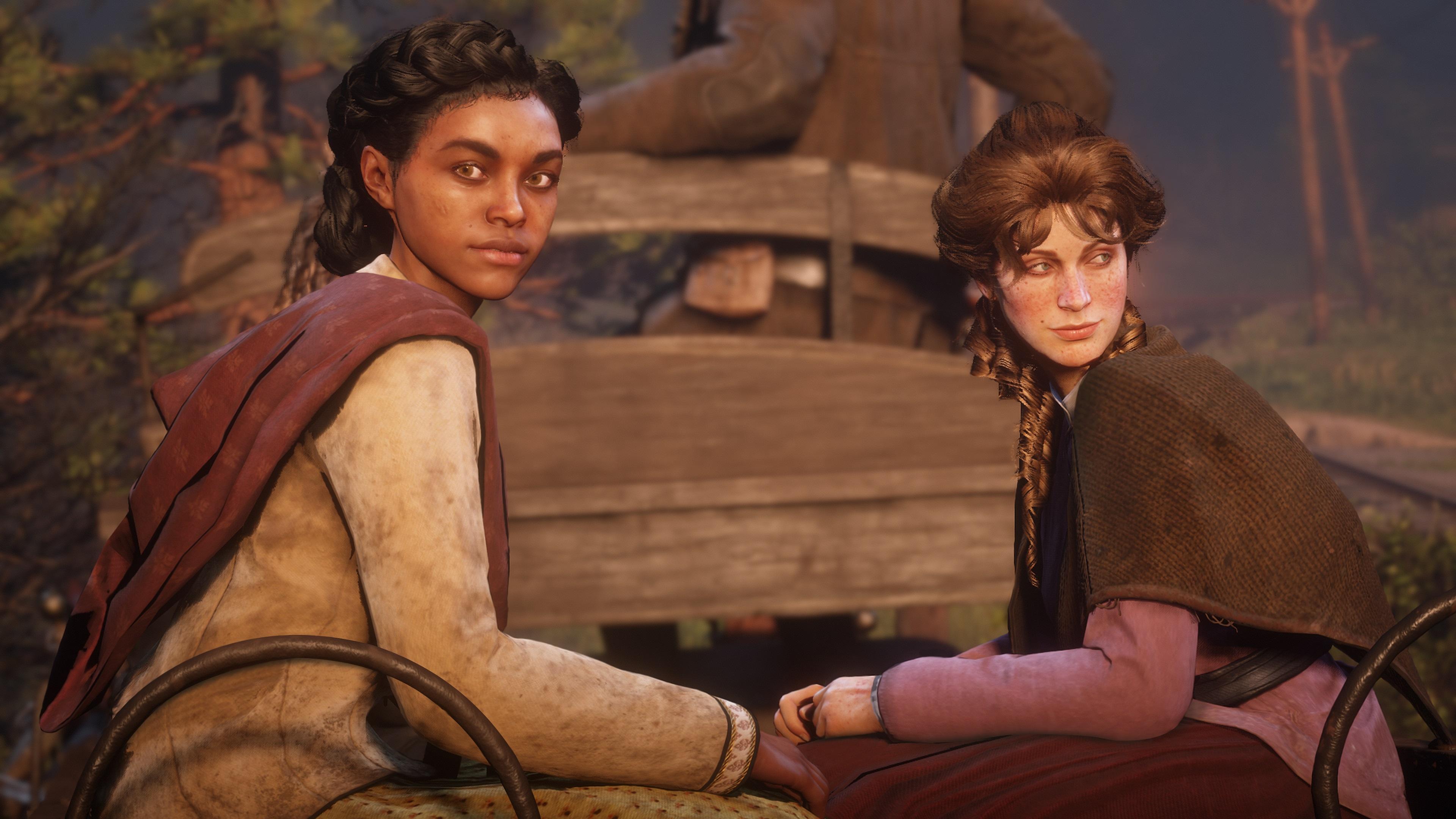 Red Dead Redemption 2 screenshot deux femmes assises dans une charrette