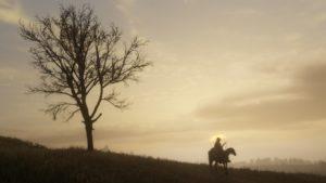 Red Dead Redemption 2 screenshot arbre et cavalier dans soleil couchant