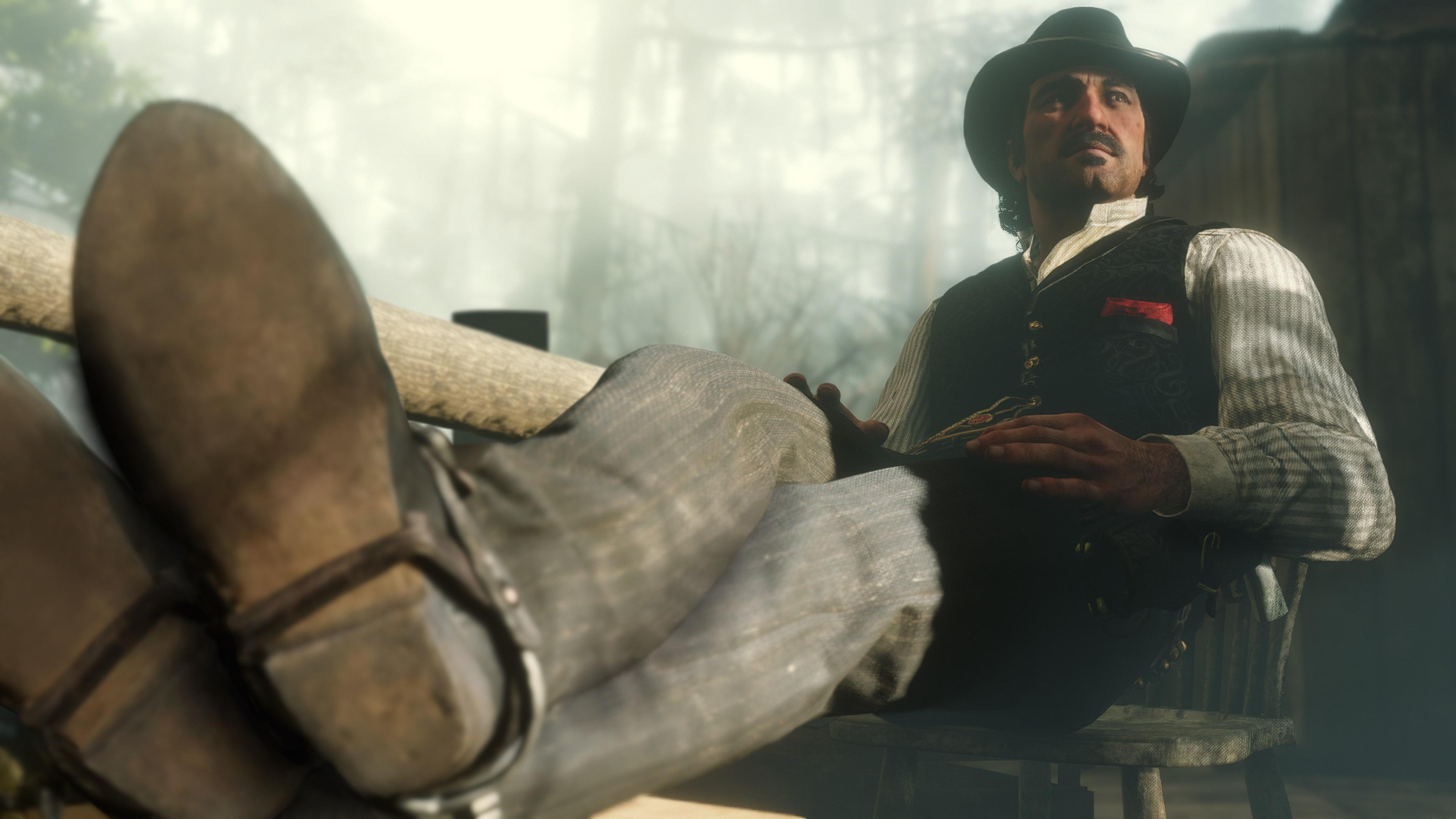 Red Dead Redemption 2 screenshot bandit assis, les pieds sur le bureau
