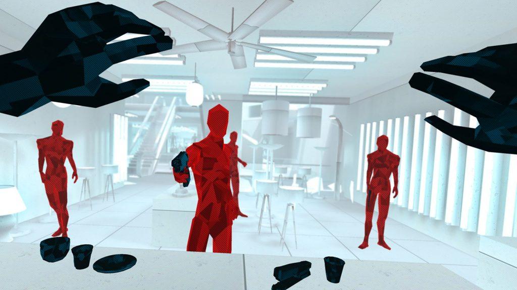 mains en l'air face à trois personnages rouge dont un pointant un pistolet vers le joueur