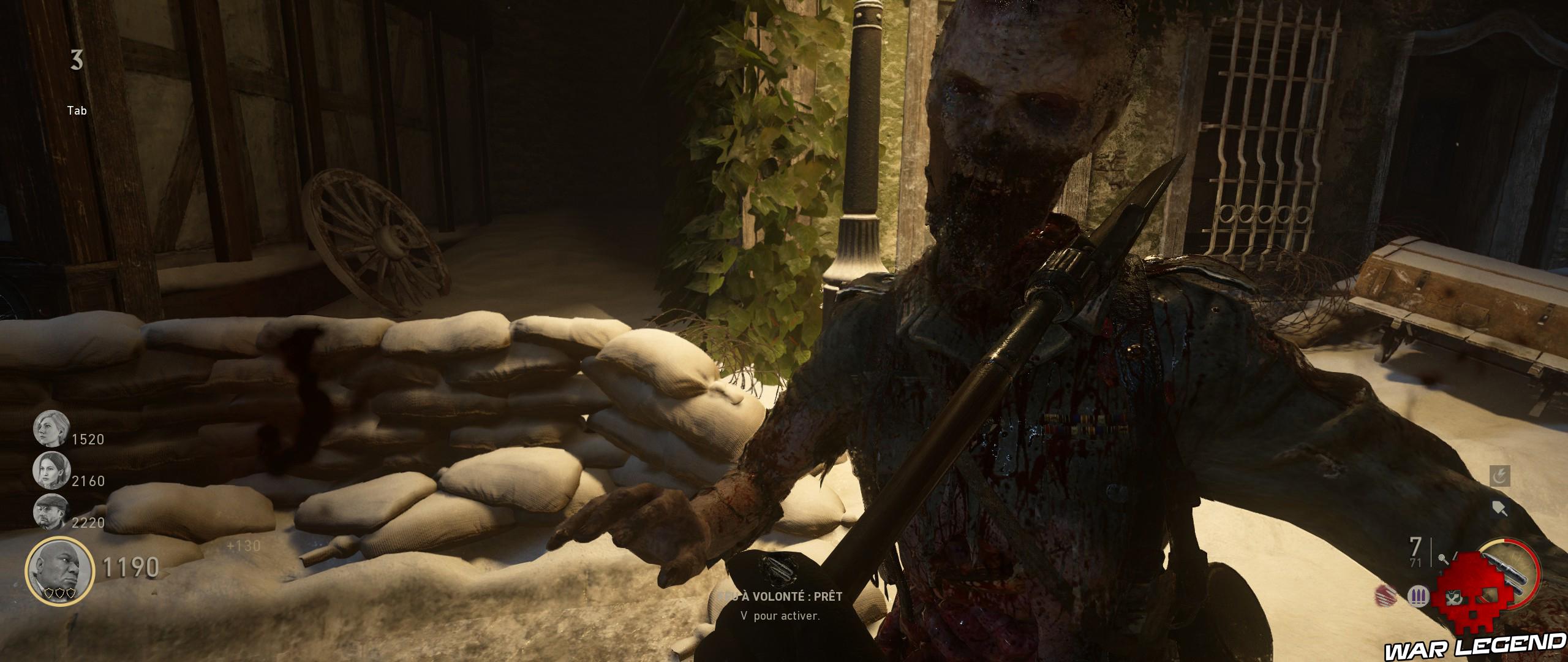 pelle enfoncée dans le cou d'un zombie