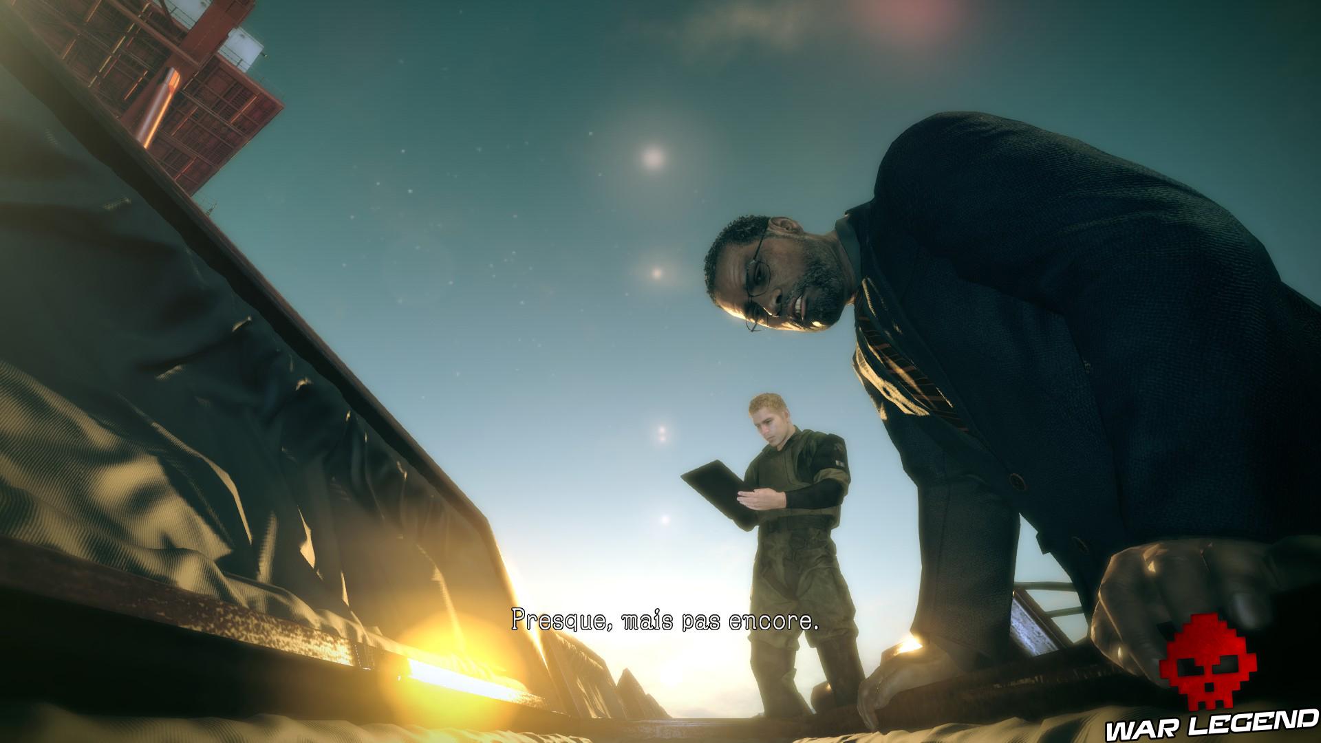 Test Metal Gear Survive Goodluck penché au-dessus d'un cercueil
