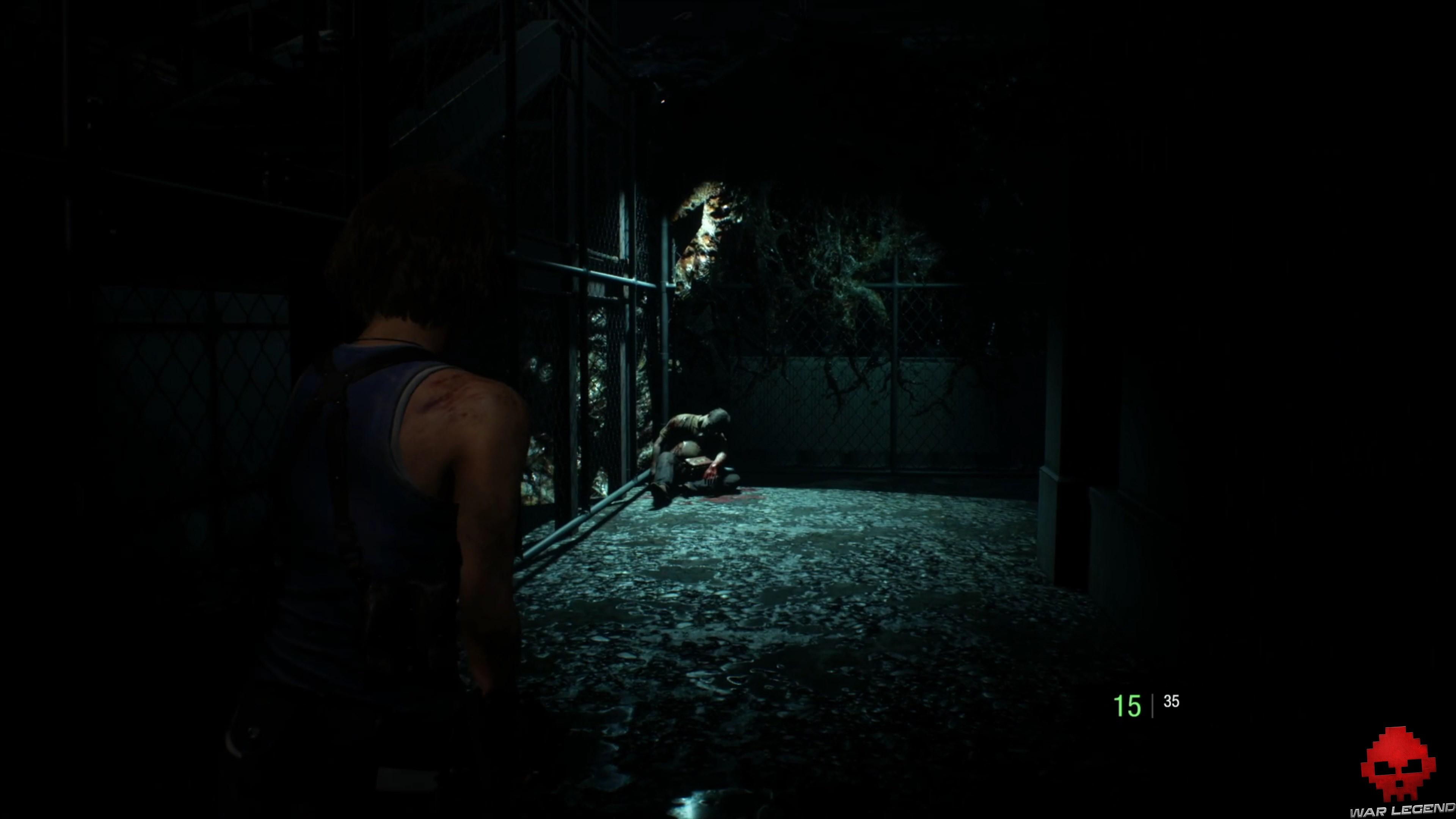 resident evil 3 cadavre adossé à un grillage